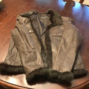 distressed leather jacket with rabbit fur trim